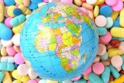 Globe showing Africa on bed of pills