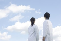 Healthcare workers gaze at clouds