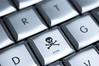 Online piracy (skull and crossbones on keyboard)